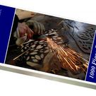 1000 Piece Puzzle. A worker uses an angle grinder on a piece of