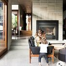 Fireplace in full tiled wall