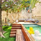 A Raised Lounge Area With A Small Pool Was Designed For This Backyard