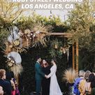 Edgy modern-bohemian Ruby Street wedding featuring impressive ceremony floral installation.