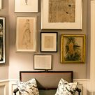 collected art on a gray wall...