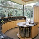 Oval kitchen island – complement the interior with elegant curved lines