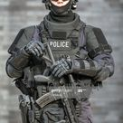 Police Officer Against Brick Wall