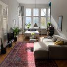 Gemütliches WG-Zimmer mit Couch und Perserteppich