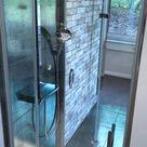 Beidseitig begehbare Dusche | ausgefallene Fliesen | Badideen Oldenburg | Regendusche | Ausstellung