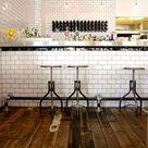 Classic white subway tile In Il parata by Oscar & Oscar. Restaurant interior design.