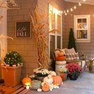 Neutral Fall Porch Decor with Pumpkins and Cornstalks   Modern Glam