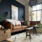 Blue wall combined with cognac couch.