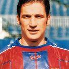 Juan Antonio Pizzi, born 7 June 1968, Spanish striker, Rosario Central (1987-1990), Deportivo Toluca FC (1990-1991), CD Tenerife (1991-1993, 1994-1996), Valencia CF (1993-1994), FC Barcelona (1996-1998), River Plate (1998–1999), Rosario Central (1999-2000), FC Porto (2000), Rosario Central (2001), Villarreal CF (2002). He mainly spent his career in La Liga and amassing top division totals of 221 games and 92 goals over the course of eight seasons. Born in Argentina, Pizzi represented the Spanish