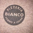 T-Shirt from Bianco Pizzeria Forno A Legna Super soft V-neck t-shirt from Bianco Pizzeria Forno A Legna (Phoenix, Arizona) Brand: DISTRICT  Size: LARGE Please see photos for the true measurements of the shirt. The color is brownish-grey. Small logo on the 'pocket' on front of the shirt, large logo printed on the back of the shirt. District Tops Tees - Short Sleeve