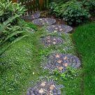 Kieselstein Mosaik im Garten legen für hübsche Wege & Terrassen