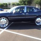 2000 Buick Park Avenue on 26s with suicide doors
