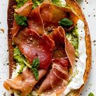 Crispy Prosciutto Tartines with Whipped Feta and Pistachio Pesto recipe by Editors  | The Feedfeed [