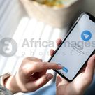 MYKOLAIV, UKRAINE   MARCH 16, 2020 Woman holding iPhone 11 with Telegram app on screen indoors, closeup Stock Photo   Download on Africa Images 40887
