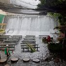 Located at the Villa Escudero Plantations and Resort in the Phillippines is the Labassin Waterfall Restaurant. The restaurant is only open for lunch and guests dine from a buffet-style menu and eat at bamboo dining tables.  It's not a natural waterfall but a spillway from the Labasin Dam. Back in the early 1900s, Don Arsenio Escudero built the country's first hydroelectric plant to supply his dessicated coconut factory and Villa, which he and his wife Dona Rosario Adap built in 1929.