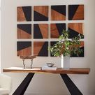 The Geometry Collection is made of slanting sections of warm woodgrain and sleek black.