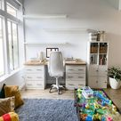 This professional-looking office and desk created from many Ikea products, including Malm, Karlby, and Kallax.