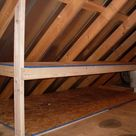 9 Tricks to Turn an Unfinished Attic Into a Practical Storage Space