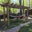 DIY pergola/hammock stand. Built out of cedar tone treated lumbar. Legs are 66 and uppers are double 28's for strength. Plan to build a couple swings to interchange with the hammock. A perfect place to relax with the fur babies and my husband.