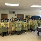 """Nurse Aide Students Gear Up. Ronnie Farlow's Certified Nurse Aide/Home Health Aide class put on their protective gear as part of their training for infection control this week. Pictured are students in complete gear, including isolation gowns, gloves and masks. """"This is all part of their training for infection control,"""" said Farlow. The students will take the Nursing Home Nurse Aide Certification exam at the end of the school year. 9/15/16"""