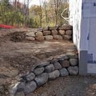 New home with boulder walls, 1