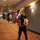 Brie Larson dressed as Captain Marvel surprises moviegoers