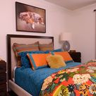 Lake Forest Project, Dallas, Texas- young man's bedroom with dog painting, red drapes, slate lamps, Global View night stands, custom bed, custom bedding, red, orange, and turquoise pairings.  This bedroom is great way to do masculine with color.