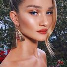Who made  Rosie Huntington-Whiteley's gold earrings?