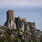 The Château de Quéribus (in Occitan Castèl de Queribús) is a ruined castle in the commune of Cucugnan in the Aude département of France. It has been listed as a monument historique by the French Ministry of Culture since 1907. Queribus is one of the