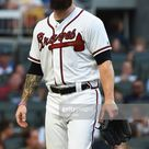Dallas Keuchel of the Atlanta Braves walks to the dugout after a...