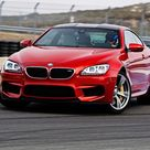 2013 BMW M6 Coupe US Version MSRP $106,100  In two years it'll be worth half that much.  Still... <3