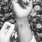 Cute and tiny anatomical heart tattoo on right wrist.
