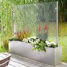 Mobiler Glas Windschutz auf Rollen