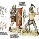A Roman and a Celt begin to battle, the Celt starting with a powerful, but useless slice to the Legionaries' scutum.