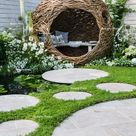 City Twitchers Garden and best of Chelsea Flower Show 2018 | woven willow bird hide (willow sculpture) and concrete circular slabs as a path over a pond
