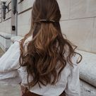 curled hair with barrette.