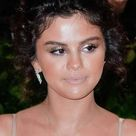 Selena Gomez Wavy Dark Brown Updo Hairstyle   Steal Her Style