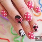 Beautiful hands and Minnie Mouse nail polish Gel