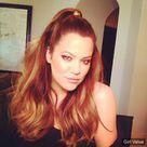 Khloe Kardashian Red Hair Ponytail in black dress