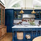[Room] Beautiful kitchen features pleasing blue paint and an arcing window in this arts and crafts home in North London. [1020 × 1318]