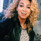 tori kelly in black jacket with short