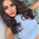 Who made Olivia Culpo's blue skirt and cropped top?