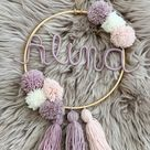 Name ring with pompom and tassels
