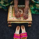 Photo of A bride flaunting the bridal mehendi design on her feet