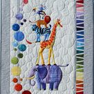 Safari Slumbers Cot Quilt or Play rug Quilt Pattern by Sue Duffy Designs featuring African Zoo animal friends at 2Sew Textiles