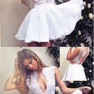 Elegantes tiefes V-Ausschnitt-Spitze-kurzes weißes Partei-Abschlussball-Kleid