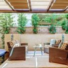Beautiful backyard patio with overhead retractable fabric CableShades