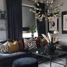 schwarze Couch und Vorhänge   Wohnen in schwarz   Kissendekoration gelb, rosa, leo und zebra