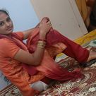 Indian girl in green salwar and orange kameez
