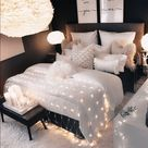 black bedroom, black accent wall, black and white bedroom, fluffy white feather ceiling lampshade
